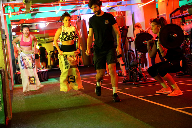 Gym members jump in sacks containing an image of Britain's Prime Minister Theresa May during a Brexfit gym class at Gym Box in London, Britain September 27, 2018. Picture taken September 27, 2018. (Photo by Simon Dawson/Reuters)