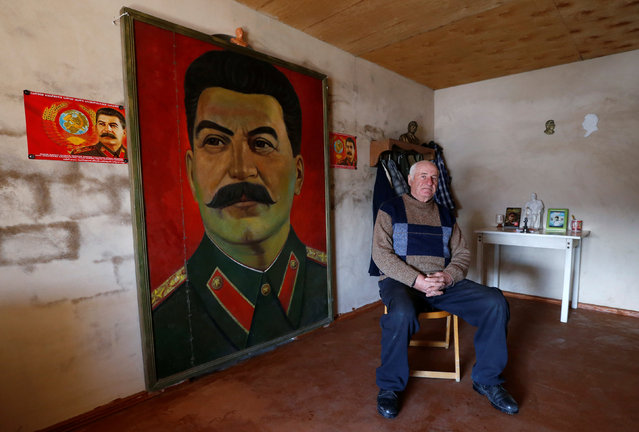 "Retired builder Vasili Sidamonidze, 70, poses for a portrait at his home in Gori, Georgia, December 6, 2016. ""Unfortunately, Stalin is not popular nowadays. Our people don't respect him. Only we, members of the (Communist) Party, respect him"", Sidamonidze said. ""I always try to attend Stalin's birthday anniversaries in Gori. Unfortunately many people don't want to join us even if they live nearby. They look at us from their windows"". Stalin, who was born in Gori in 1878 and died in 1953, is largely reviled today in Georgia, which regained its independence during the 1991 collapse of the Soviet Union. Over the years, his memorials have been dismantled, most recently in 2010 when authorities removed a statue of the dictator from Gori's central square. But Stalin is still revered by a small group of mainly elderly supporters who stress his role in the industrialisation of the Soviet Union and in defeating Nazi Germany in World War Two. Each Dec. 21, a few dozen people mark his birthday by gathering outside a Gori museum dedicated to Stalin, where they make speeches and walk to the square where a 6-meter-high bronze statue of him once stood, calling for it to be reinstated. Opponents say it was a symbol of Moscow's still lingering shadow. In 2008, Russia fought a brief war with Georgia and recognised its breakaway regions of Abkhazia and South Ossetia as independent states. (Photo by David Mdzinarishvili/Reuters)"