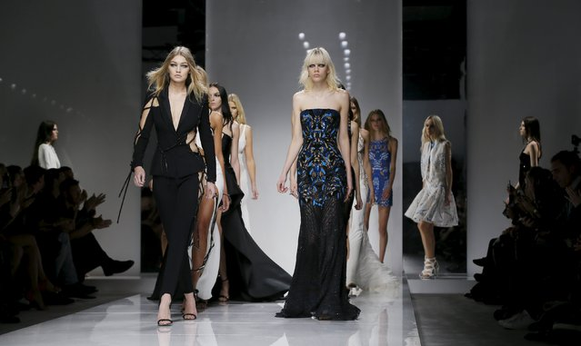 Models present creations by Italian designer Donatella Versace as part of her Haute Couture Fall/Winter 2016/2017 fashion show for Atelier Versace in Paris January 24, 2016. (Photo by Gonzalo Fuentes/Reuters)