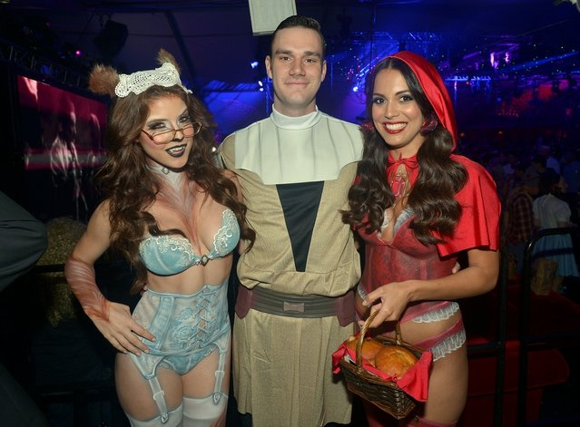 (L-R) Playmate Amanda Cerny, Cooper Hefner and Playmate of the Year Raquel Pomplun attend Playboy Mansion's annual Halloween bash on October 26, 2013 in Holmby Hills, California. (Photo by Charley Gallay/Getty Images for Playboy)