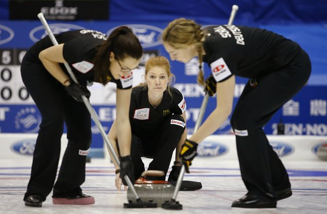Germany's second Stella Heiss (C) watches as her team mates Daniela Driendl (L) and Pia-Lisa Schoell sweep during their curling round robin game against Sweden at the World Women's Curling Championships in Sapporo March 14, 2015. (Photo by Thomas Peter/Reuters)