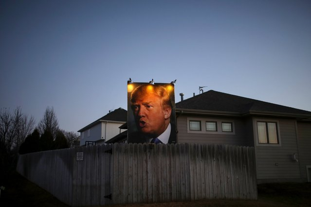 A giant poster of Republican presidential candidate Donald Trump stands in the backyard of a supporter in West Des Moines, Iowa, on January 28, 2016. (Photo by Christopher Furlong/Getty Images)