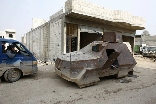 A makeshift armoured vehicle of the Kurdish People's Protection Units (YPG) is parked in the northern Syrian town of Kobani January 28, 2015. (Photo by Osman Orsal/Reuters)