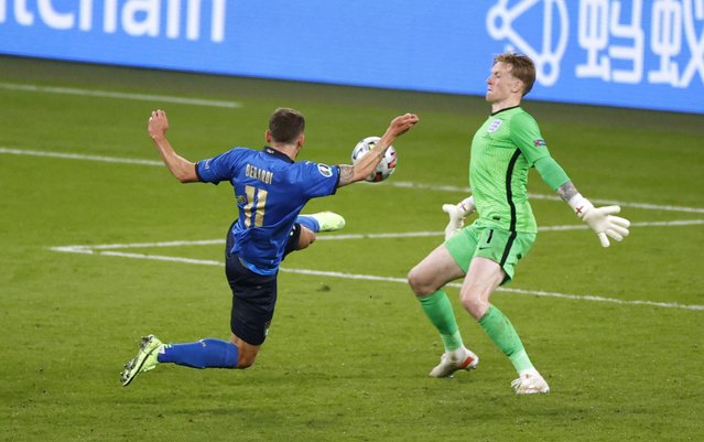 Domenico Berardi of Italy shoots as England goalkeeper Jordan Pickford comes out of his goal during the UEFA Euro 2020 Championship Final between Italy and England at Wembley Stadium on July 11, 2021 in London, United Kingdom. (Photo by John Sibley/Reuters)