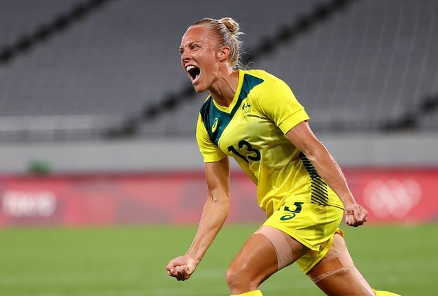 Tameka Yallop #13 of Team Australia celebrates after scoring their side's first goal during the Women's First Round Group G match between Australia and New Zealand during the Tokyo 2020 Olympic Games at Tokyo Stadium on July 21, 2021 in Chofu, Tokyo, Japan. (Photo by Edgar Su/Reuters)