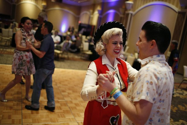 In this April 4, 2015, photo, Zack Simpson, right, and Dollie Simpson dance during a jive class at the Viva Las Vegas Rockabilly Weekend in Las Vegas. Dance classes were held for Bopping, Jiving, Strolling and the Texas Two-Step. (Photo by John Locher/AP Photo)