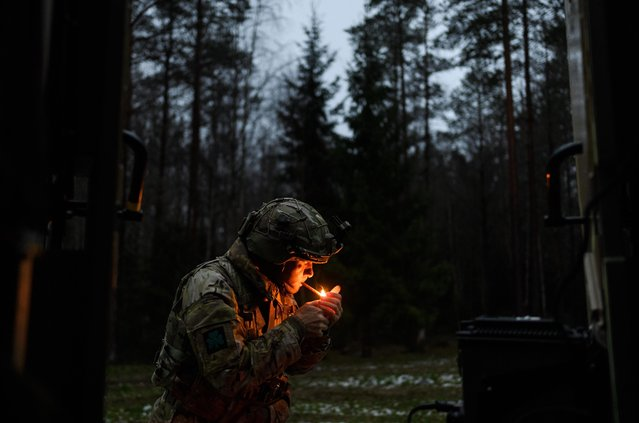 Major Paul Martin of B Company of the Royal Irish Regiment lights a cigar after setting up camp near a forest during the live exercise on November 2, 2018 in Unset, Norway. (Photo by Leon Neal/Getty Images)