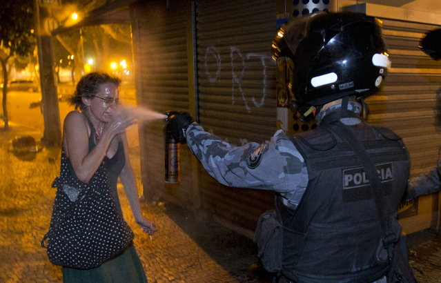 A military police peper sprays a protester during a demonstration in Rio de Janeiro, Brazil, Monday, June 17, 2013. (Photo by Victor R. Caivano/AP Photo)