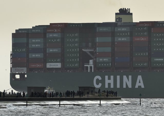 Onlookers watch from a harbour wall as the largest container ship in world, CSCL Globe, docks during its maiden voyage, at the port of Felixstowe in south east England, in this January 7, 2015 file photo. China is expected to releas exports, imports and trade surplus for March this week. (Photo by Toby Melville/Reuters)