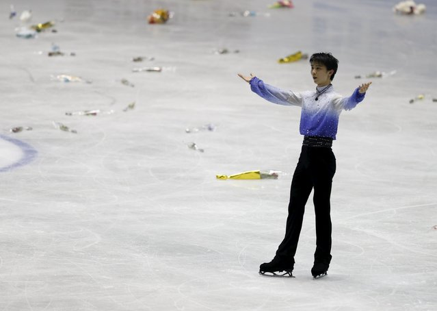 Yuzuru Hanyu of Japan reacts after competing his men's short program at the ISU World Team Trophy in Figure Skating in Tokyo April 16, 2015. (Photo by Yuya Shino/Reuters)