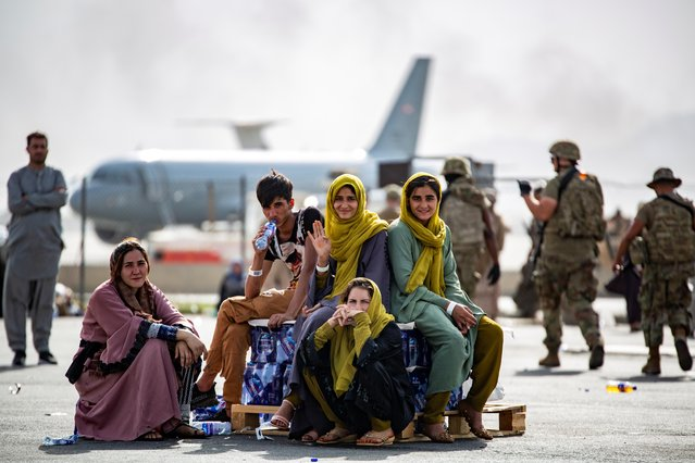 Evacuee children wait for the next flight after being manifested at Hamid Karzai International Airport, in Kabul, Afghanistan, August 19, 2021. (Photo by 1stLt. Mark Andries/U.S. Marine Corps/Handout via Reuters)