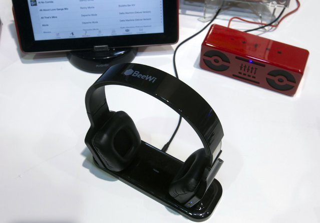 "BeeWi BBH300 headphones are displayed during ""CES Unveiled"", a media preview event to the annual Consumer Electronics Show (CES), in Las Vegas, Nevada, January 5, 2014. The headphones steam music from a smartphone or MP3 player but can also forward the music to a stereo when attached to a docking station. The $300 headphones are expected to ship in a few weeks, a representative said. (Photo by Steve Marcus/Reuters)"