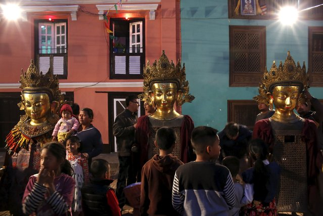 Devotees stand near idols of Buddha during the Samyak festival in Lalitpur, Nepal, March 11, 2016. (Photo by Navesh Chitrakar/Reuters)