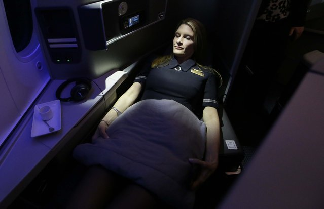 Flight attendant Angie Wells checks out the seating accommodations of American Airlines' first Boeing 787 Dreamliner at the airline's maintenance hangar at Dallas-Fort Worth International Airport, Wednesday, April 29, 2015, in Grapevine, Texas. (Photo by L. M. Otero/AP Photo)
