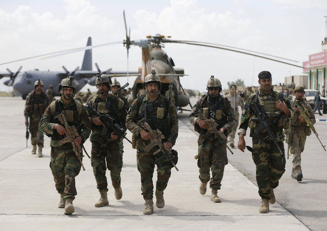 Afghan security forces arrive at the Kunduz airport, April 30, 2015. The Afghan army and police on Thursday failed to expel Taliban fighters from the outskirts of a besieged provincial capital as a seventh day of fierce fighting put pressure on national forces struggling largely without U.S. military backup. (Photo by Omar Sobhani/Reuters)