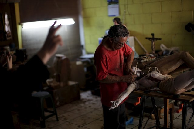 Manuel de Jesus Quilizapa works on a statue of El Jesus Nazareno in his workshop in Izalco, El Salvador March 11, 2016. Quilizapa, who took over the business from his father, is one of a small number of artists still working on traditional religious art in El Salvador. (Photo by Jose Cabezas/Reuters)