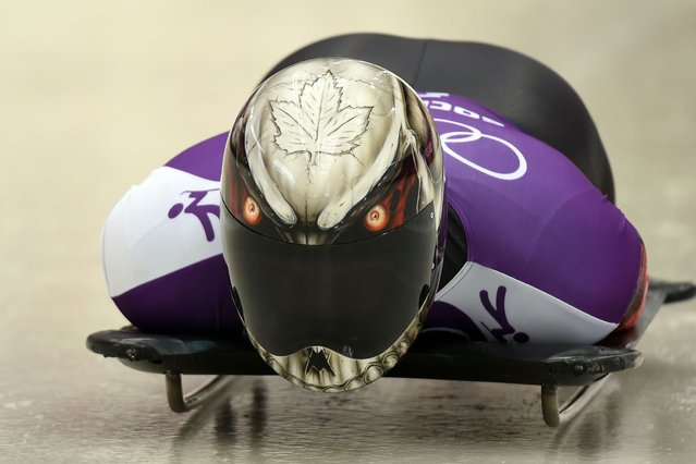 Canada's Eric Neilson takes part in a men Skeleton official training at the Sanki Sliding Center in Rosa Khutor during the Sochi Winter Olympics on February 10, 2014. (Photo by Leon Neal/AFP Photo)
