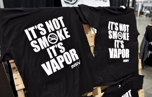 T-shirts on display at the Vape Summit 3 in Las Vegas, Nevada May 2, 2015. New research provided to Reuters has found that performing tricks is one of the top two reasons young users say they consider the devices cool. (Photo by David Becker/Reuters)