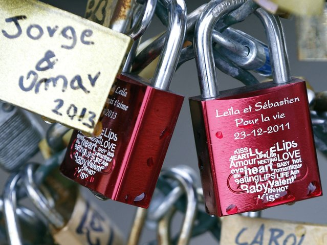 """There are two bridges in Paris with the locks, you must be very careful which bridge you put your lock on because Pont des Arts is for your committed love, while Pont de l'Archevêché is for your lover"". (Photo by Charles Platiau/Reuters)"