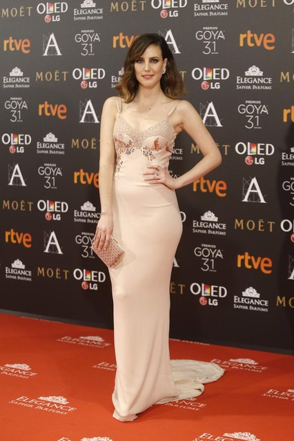 Spanish actress Natalia de Molina poses for photographers before the Goya Film Awards Ceremony in Madrid, Saturday, February 4, 2017. The Goya Awards are Spain's main national annual film awards. (Photo by Francisco Seco/AP Photo)