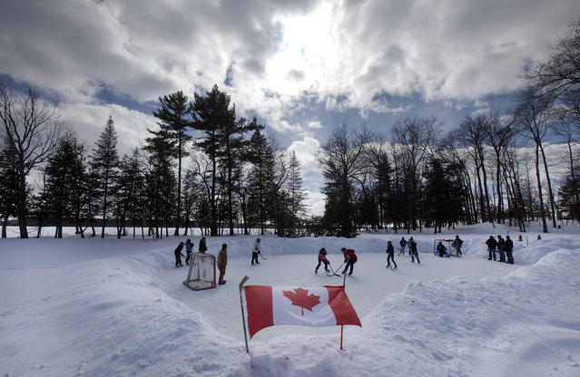 6. CANADA: Youths play pond hockey on Pigeon Lake near the town of Bobcaygeon, in the Kawartha Lake region of central Ontario March 2, 2014. (Photo by Fred Thornhill/Reuters)