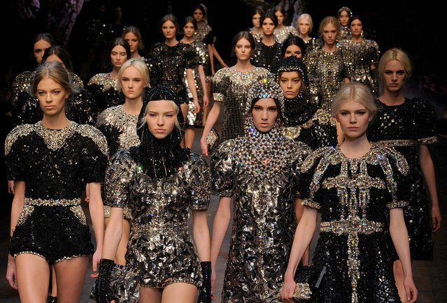 Models on parade at the end of the Dolce & Gabbana women's Fall-Winter 2014-15 collection, part of the Milan Fashion Week, unveiled in Milan, Italy, Sunday, February 22, 2014. (Photo by Giuseppe Aresu/AP Photo)