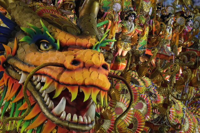 Performers from the Beija Flor samba school parade on a float during carnival celebrations at the Sambadrome in Rio de Janeiro, Brazil, Monday, March 3, 2014. (Photo by Felipe Dana/AP Photo)