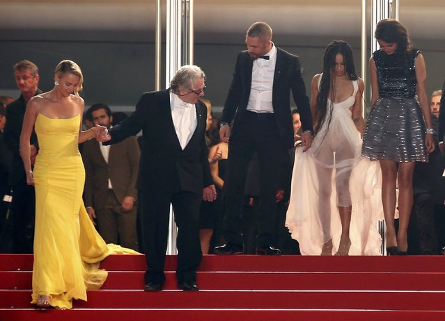"""(L-R) Cast member Charlize Theron, director George Miller, cast members Tom Hardy, Zoe Kravitz and Courtney Eaton walk on the red carpet as they leave after the screening of the film """"Mad Max: Fury Road"""" out of competition at the 68th Cannes Film Festival in Cannes, southern France, May 14, 2015. (Photo by Eric Gaillard/Reuters)"""