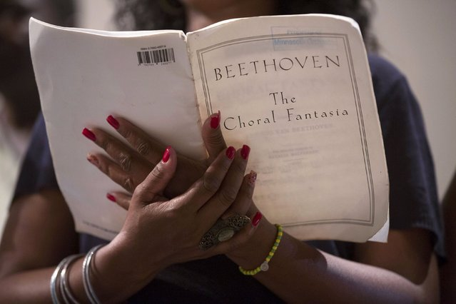 A member of the Cuban National Choir holds a Beethoven score during a rehearsal with the Minnesota Orchestra in Havana May 14, 2015. (Photo by Alexandre Meneghini/Reuters)