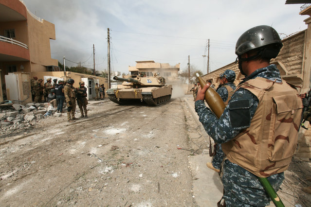 Iraqi security forces member is pictured during a battle with Islamic State's militants in al-Josaq district in western Mosul, Iraq February 27, 2017. (Photo by Azad Lashkaril/Reuters)