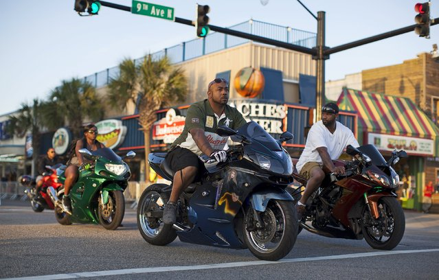 Bikers cruise down Ocean Boulevard during the 2015 Atlantic Beach Memorial Day BikeFest in Myrtle Beach, South Carolina May 22, 2015. (Photo by Randall Hill/Reuters)