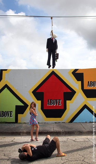 Effigy Of Wall Street Banker Hangs By Freeway In Miami