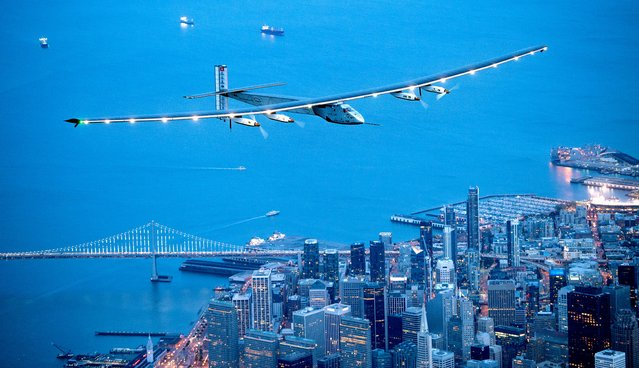 Solar Impulse 2 flies over San Francisco on Saturday, April 23, 2016. The solar-powered airplane, which is attempting to circumnavigate the globe to promote clean energy and the spirit of innovation, arrived from Hawaii after a three-day journey across the Pacific Ocean. (Photo by Noah Berger/AP Photo)
