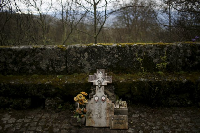 A tombstone is seen next to the church in Povoa de Agracoes near Chaves, Portugal, April 19, 2016. (Photo by Rafael Marchante/Reuters)
