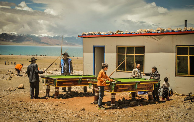 Finalist, People category. A group of locals playing billiards by Namtso Lake, Tibet. (Photo by Vincent Cheng/Smithsonian.com)