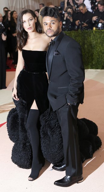 """Model Bella Hadid (L) and singer The Weeknd (R) arrive at the Metropolitan Museum of Art Costume Institute Gala (Met Gala) to celebrate the opening of """"Manus x Machina: Fashion in an Age of Technology"""" in the Manhattan borough of New York, May 2, 2016. (Photo by Eduardo Munoz/Reuters)"""