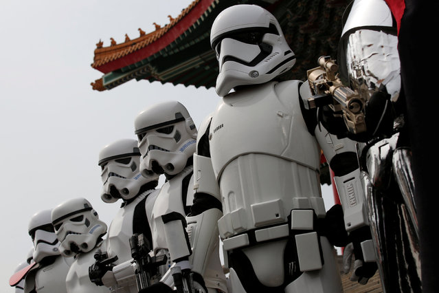 Fans dressed as Storm Troopers from Star Wars pose for a photo during Star Wars Day in Taipei, Taiwan, May 4, 2016. (Photo by Tyrone Siu/Reuters)