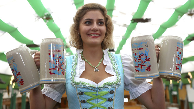 Elena poses with the new official Oktoberfest 2019 beer mugs in Munich, Germany, Thursday, August 29, 2019. The world largest beer festival starts on Sept. 21, 2019 and runs untill Oct. 6, 2019. (Photo by Matthias Schrader/AP Photo)