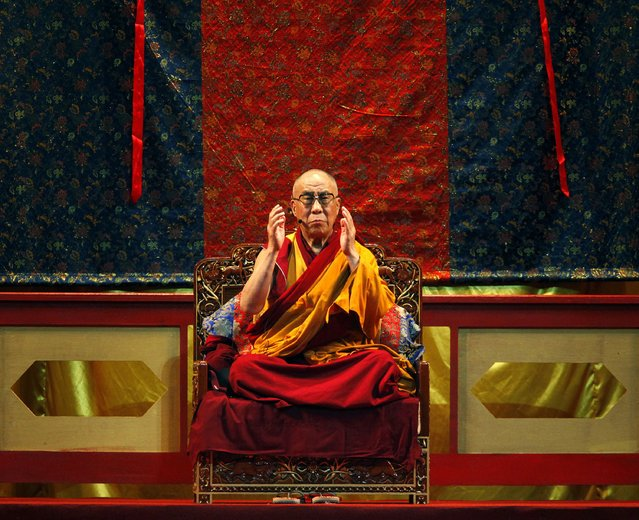 Exiled Tibetan spiritual leader, the Dalai Lama, speaks to followers during a mass prayer session for Typhoon Morakot victims in Kaohsiung, southern Taiwan, in this September 1, 2009 file photo. The Dalai Lama will turn 80 on July 6. (Photo by Nicky Loh/Reuters)