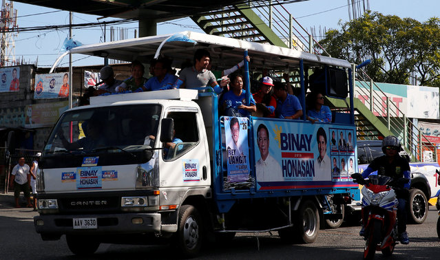 A motorcade of Presidential candidate Jejomar Binay and Filipino boxer and Senatorial candidate Manny Pacquiao passes by during election campaigning in Malabon Metro Manila in the Philippines May 6, 2016. (Photo by Erik De Castro/Reuters)
