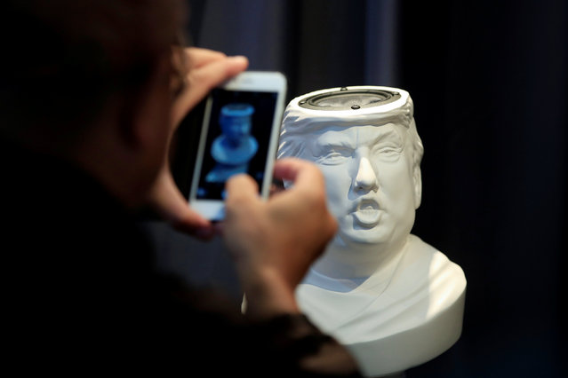 A man takes picture of a Sound Of Power speaker in the shape of a bust of Donald Trump is displayed at the CES (Consumer Electronics Show) Asia 2016 in Shanghai, China May 13, 2016. (Photo by Aly Song/Reuters)