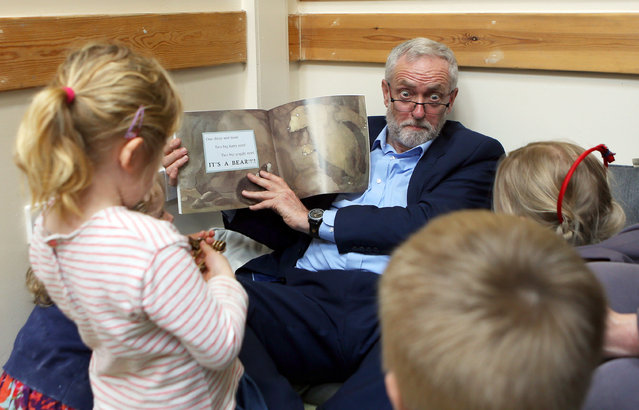"""Labour party leader Jeremy Corbyn reads the book """"We're Going on a Bear Hunt"""" to children at a visit to Brentry Children's Centre, on April 21, 2017 in Bristol, England. In an attempt to gain a larger Brexit mandate the Conservative Prime Minster Theresa May made the shock announcement to hold a snap general election on June 8th 2017 sending the country back to the polls for the second time in two years. (Photo by  Steve Parsons/PA Wire)"""