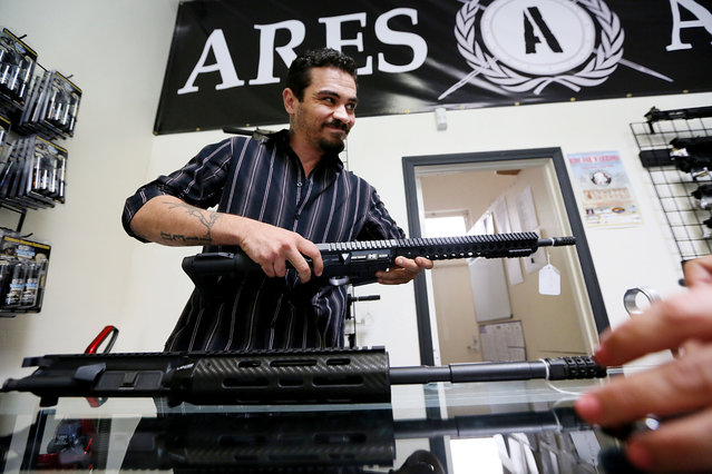 Karras shows an AR-15 rifle at his store in Oceanside, Calif. Ares Armor makes the gun part out of plastic instead of the ATF-mandated metal. The AR-15-style semiautomatic assault rifle reportedly contains markings that alert the gun owner where to drill. (Photo by Sandy Huffaker for The Washington Post)