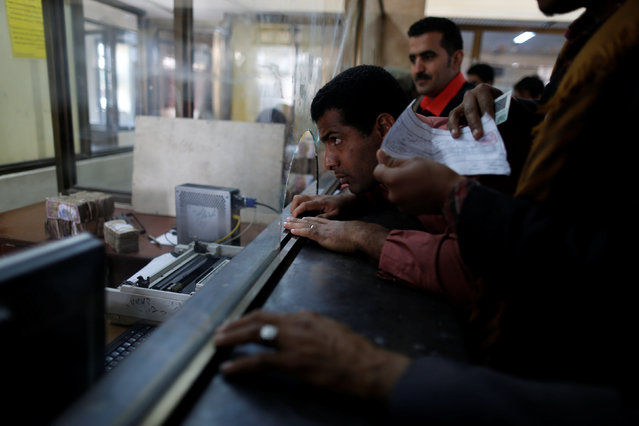 A public sector employee waits to receive his salary at a post office in Sanaa, Yemen January 25, 2017. (Photo by Khaled Abdullah/Reuters)