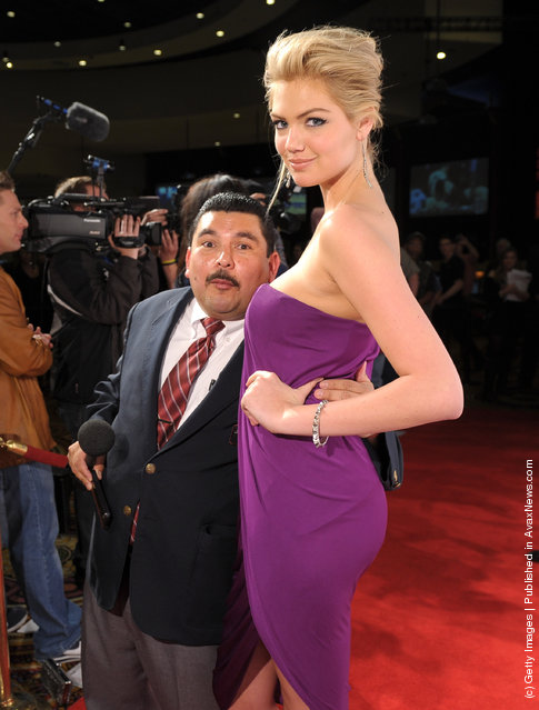 Guillermo Rodriguez and Sports Illustrated Swimsuit Issue cover model Kate Upton arrive at Club SI Swimsuit