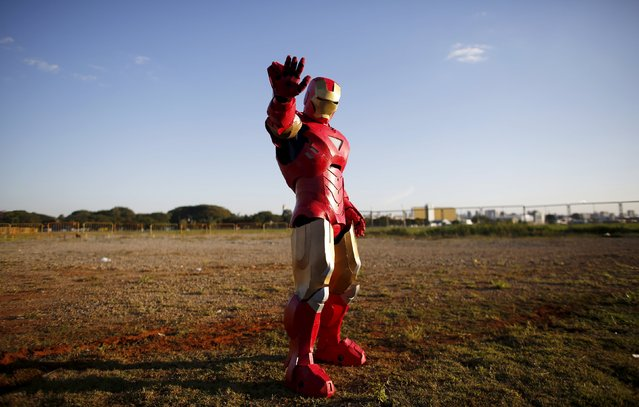 "A cosplay enthusiast poses as Iron Man during the ""Anime Friends"" annual event in Sao Paulo July 19, 2015. (Photo by Nacho Doce/Reuters)"