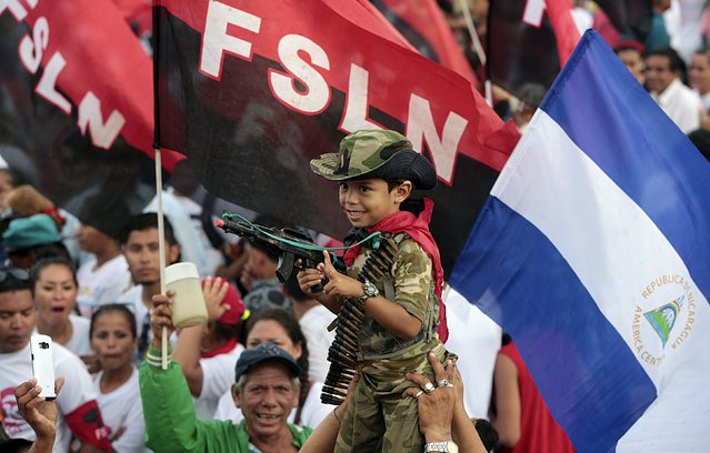A boy dressed as a military takes part in celebrations to mark the 36th anniversary of the Sandinista Revolution at Juan Pablo II Square in Managua, Nicaragua July 19, 2015. (Photo by Oswaldo Rivas/Reuters)