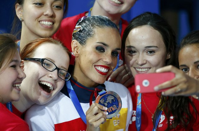 Silver medal winner Ona Carbonell of Spain makes a selfie with volunteers after the synchronised swimming solo technical final at the Aquatics World Championships in Kazan, Russia July 25, 2015. (Photo by Michael Dalder/Reuters)