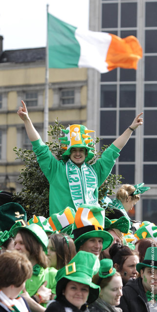 Parade goer watches the St Patrick's Day festivities in Dublin, Ireland