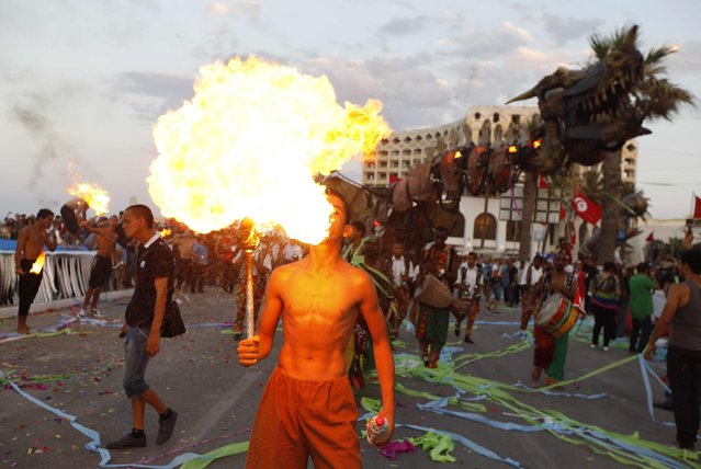 A fire breather performs during the Aoussou Carnival in Sousse, Tunisia July 26, 2015. (Photo by Anis Mili/Reuters)
